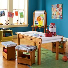 The Land of Nod. I love this playroom. Love the art clips, easel, toy bin, and desk!