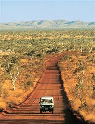 Karratha, W. Oz.  We did a lot of driving on these red, red roads.  It was very dusty so we usually had something over our nose and mouth