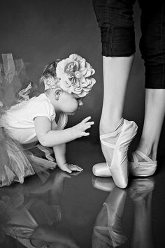 Momma, teach me to dance.  My lovely daughter, you will fly.  Mom and baby girl.