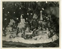 Vintage Photograph of Christmas Village Putz Houses under the Christmas Tree.