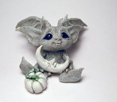 A cute crafted baby green goblin. This item is a wonderful display piece and is epic for any collectors of the genre. Your order will be safely packaged and delivered in excellent condition. Dimensions: Height ~ 104mm / 4.1 inchPlease notice that each item is handcrafted and may vary slightly from the pics. Polymer Clay Sculptures, Sculpture Clay, Garden Sculpture, Polymer Clay Projects, Polymer Clay Creations, Clay Fairies, 3d Fantasy, Baby Fairy, Ideias Diy