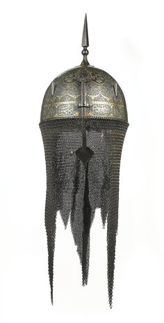 A Qajar silver and gold-overlaid steel helmet (dahl) and matching shield (khula khud), Persia, 19th century