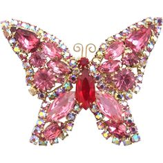 Vintage Weiss Pink Rhinestone Butterfly Pin. I happen to have this in pink, green, and white.
