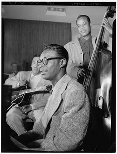 """Oscar Moore with Gibson ES-300, Nat """"King"""" Cole, and Wesley Prince, July 1946; photo by William Gottlieb"""