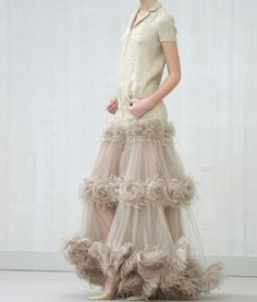 CHANEL...Spring 2004 omgosh I love this! It's like a triple tutu...Not too crazy about the top but would wear it with the zipper down or lace under...wear was I my senior year? This could have been my homecoming/prom dress!