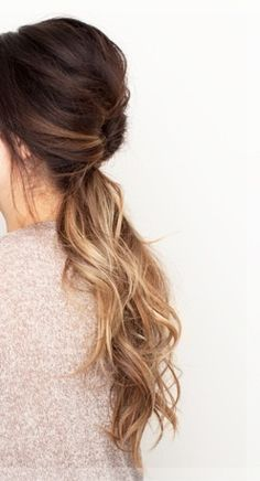 Loosely curled long ponytail with brunette ombre