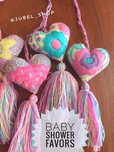 Hand #embroidered hearts for unique baby showers favors. Handmade in Mexico. Enquiries and wholesale: jubelshop@outlook.com  #babyshower #favors #baby #partysupplies #favorbags #handmade #tassel #pompom