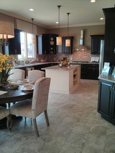 Love dark cabinets & paint color... Not a fan of random white in middle