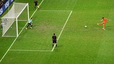 Robin van Persie of the Netherlands scores a penalty kick