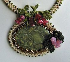 Inspiration:Gorgeous textural components on this bezel... love the leaves and berries!