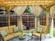 diy outdoor curtains. by annabelle  like that the drapes aren't white and the string lights