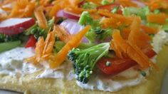 Crescent-roll dough, baked in a log, becomes the perch for a ranch-dressing spread and fresh, crunchy vegetables.