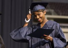 Nicole D. Lee turning the tassel of her cap after receiving her degree.  Penn State-Harrisburg held it's Fall 2014 commencement at the Giant Center in Hershey, on Saturday, December 20 2014.  Daniel Zampogna, PennLive