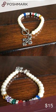 Jewel tones pearl like bracelet w/ cross charm Never worn Jewelry Bracelets