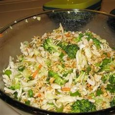 Mad Hatter Salad Recipe - a must for broccoli salad lover's!  Ramens, cabbage slaw mix, toasted almonds and sunflowers seeds.