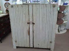 $195 - This is a great old primitive piece. Double beadboard doors and three shelves inside. The cabinet measures 45 inches across the front, 16 inches deep and it stands 49 inches tall. It can be seen in Booth EF at Main Street Antique Mall 7260 East Main St ( E of Power Rd ) Mesa 85207  480 9241122open 7 days 10 till 530  Cash or charge 30 day layaway also available