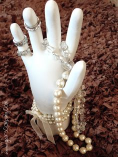Jewelry plaster--A plaster hand made with a rubber glove and plaster.  Makes a lovely jewelry holder for your dresser or to safeguard your rings near the sink.