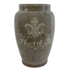 Add a touch of French country flair to your living room or foyer with this beautiful terracotta vase, showcasing a fleur-de-lis design with text detailing.