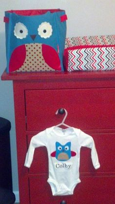 Aqua & Red Owl Nursery (ikea dresser, Skip Hop bin, changing pad cover via etsy, personalized owl onesie via sweetlilytutus on etsy:  http://www.etsy.com/listing/118367052/personalized-baby-onesie-with-blue-owl)