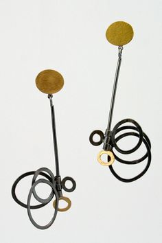 Sydney Lynch black and gold long bubble earrings