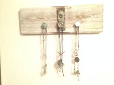 Old piece of wood found in a scrap pile outside antique store.  Added knobs.   Fun way to display my fave necklaces