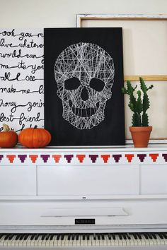 Need an easy #halloween #decoration? Grab an old canvas, string, nails and TA DA!