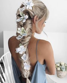 quirky hair ideas. flowers in braid.