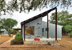 For a cost-conscious 2,000-square-foot renovation located 30 minutes outside of Austin, Texas, architect Nick Deaver took a look around for inspiration. He spied galvanized metal cladding on the region's sheds and co-opted the inexpensive, resilient material for his own design.