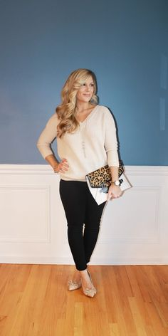 Outfitted411: Sweater & Skin...tan sweater, black jeans, leopard print clutch, nude bow heels