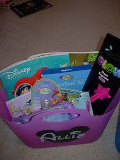 Themed goody/activity bags - here for a trip to Disneyland by the Disney Diva - like the stand-up/wipe-down plastic 'bag'!