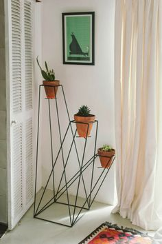 i need this plant stand in my life.