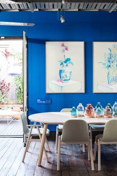 This bright blue is an excellent background for these pieces of art. They just pop off the wall.