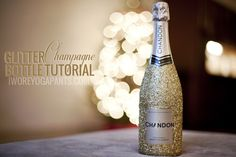 Glitter Champagne Bottle DIY: perfect for your Gatsby Party. #champagne #glitter #partyatgatsby's