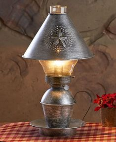 Reminiscent of the old days when lanterns were used, this antique finished table lamp brings history and style to any room décor. Light up your space with this rustic lamp.