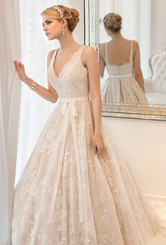 Ball gown featuring hand-sewn jewels on corded lace. Scalloped lace trim runs along the V-neck, shoulder straps and hem.More Details From Essense of Australia