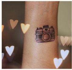 Camera tattoo because I love taking pictures.
