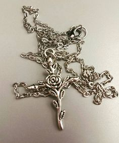 Check out this item in my Etsy shop https://www.etsy.com/listing/468721836/rose-cross-necklace-gothic-cross