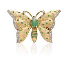 AN EMERALD AND DIAMOND BUTTERFLY BROOCH