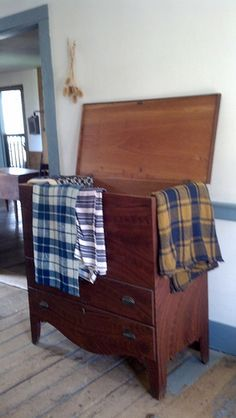 Primitive blanket chest with early textiles.