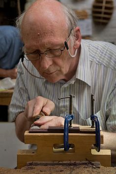 Totnes School of Guitarmaking, carving the bridge.