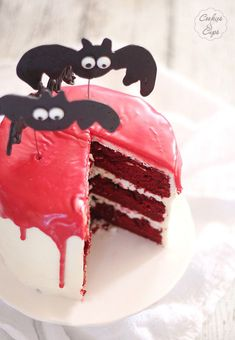 Vampire Bat Cake How-To ~ This Vampire Bat Cake is a Red Velvet Cake with a red ganache. The bats are made from melted chocolate and so easy!