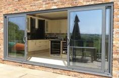 Aluminium windows versus wood pvc cherwell windows for Triple french doors exterior
