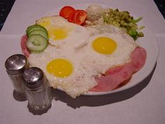 """uitsmijter ham en kaas."" Dutch bouncer. 2 sunny side up eggs with ham & cheese variation + trimmings"