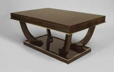 French Art Deco style rosewood rectangular coffee table with chrome trim and bone inlaid detail on apron with a platform base supporting 4 shaped legs (style of SORNAY)