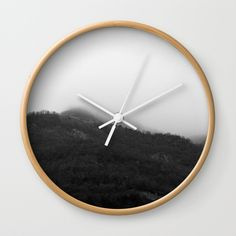 "Foggy Mountains Wall Clock by ARTbyJWP via Society6 #clocks #wallclock #walldeco #homedecor #homeoffice #shop #shopping - Available in natural wood, black or white frames, our 10"" diameter unique Wall Clocks feature a high-impact plexiglass crystal face and a backside hook for easy hanging. Choose black or white hands to match your wall clock frame and art design choice. Clock sits 1.75"" deep and requires 1 AA battery (not included)."