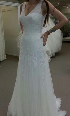 I like this, but it doesn't show the back. Pronovias Landra, find it on PreOwnedWeddingDresses.com