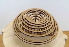 Dean O'Callaghan created a wooden automaton machine that mimics the splash after a water droplet hits a puddle. All parts of the machine were hand made.