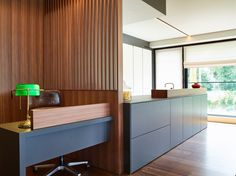This SieMatic Kitchen Extends Into An Office Area With A Modern Mix