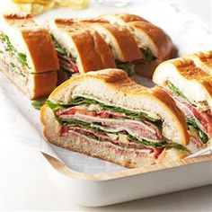 Layered Picnic Loaves Recipe -This big sandwich, inspired by one I tried at a New York deli, is a favorite with our football-watching crowd. Made ahead, it's easily carted to any gathering. Kids and adults alike say it's super. -Marion Lowery, Medford, Oregon