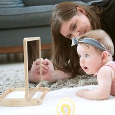 Become your child's first teacher with this beautiful collection of Montessori infant toys and parent support materials designed by child development experts. Together these toys promote concentration, visual tracking, core development, grasp development, an early love of reading, and pre-crawling movements.